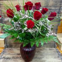 Short Stem Red Roses in Coloured Glass Vase