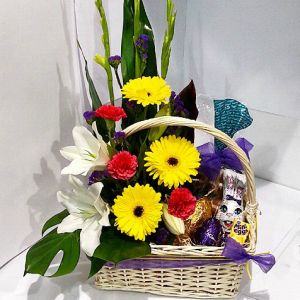 Easter basket with Flowers, Easter Eggs and Hot Cross Buns